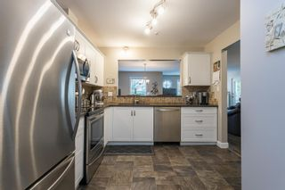 """Photo 2: 107 5909 177B Street in Surrey: Cloverdale BC Condo for sale in """"Carridge Court"""" (Cloverdale)  : MLS®# R2602969"""