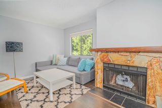 "Photo 2: 202 7095 133B Street in Surrey: West Newton Townhouse for sale in ""Sun Creek"" : MLS®# R2614920"