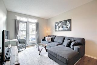 Photo 4: 1103 125 Panatella Way NW in Calgary: Panorama Hills Row/Townhouse for sale : MLS®# A1143179