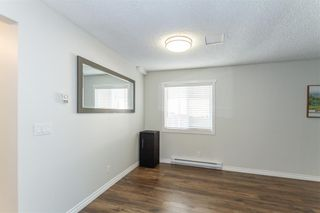 Photo 4: 19881 53 Avenue in Langley: Langley City 1/2 Duplex for sale : MLS®# R2607336