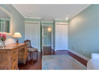 """Photo 18: 28 21746 52 Avenue in Langley: Murrayville Townhouse for sale in """"Glenwood Village Estates"""" : MLS®# R2599658"""