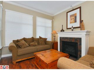 """Photo 2: 5723 148B Street in Surrey: Sullivan Station House for sale in """"Panorama Village"""" : MLS®# F1010272"""