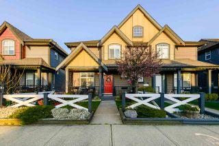 Photo 1: 7310 192 Street in Surrey: Clayton 1/2 Duplex for sale : MLS®# R2559075