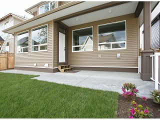 "Photo 9: 7772 211TH Street in Langley: Willoughby Heights House for sale in ""Yorkson South"" : MLS®# F1310398"