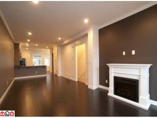 """Photo 3: 14 15192 62A Avenue in Surrey: Sullivan Station Townhouse for sale in """"ST. JAMES GATE"""" : MLS®# F1104157"""