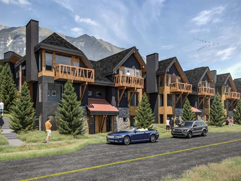 Main Photo: 102F 1200 Three Sisters Parkway: Canmore Row/Townhouse for sale : MLS®# A1056458