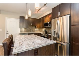 """Photo 5: 210 6490 194 Street in Surrey: Clayton Condo for sale in """"WATERSTONE ESPLANADE GRANDE"""" (Cloverdale)  : MLS®# R2603405"""