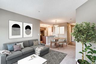 Photo 2: 6205 403 Mackenzie Way SW: Airdrie Apartment for sale : MLS®# A1145558