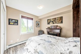 Photo 15: 7410 304 Mackenzie Way SW: Airdrie Apartment for sale : MLS®# A1149163