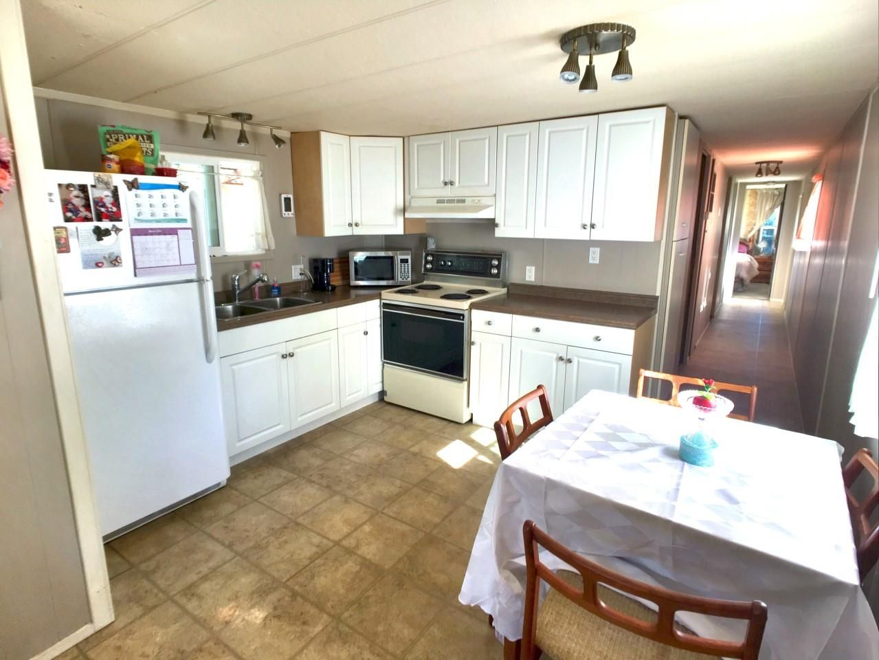 "Main Photo: 8 24330 FRASER Highway in Langley: Otter District Manufactured Home for sale in ""Langley Grove Estates"" : MLS®# R2344818"