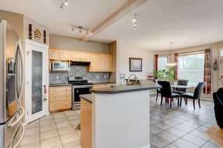 Photo 2: 250 Elmont Bay SW in Calgary: Springbank Hill Detached for sale : MLS®# A1119253