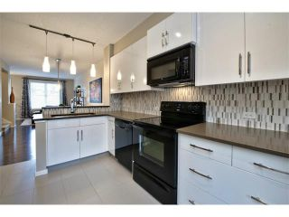 Photo 5: 312 ASCOT Circle SW in Calgary: Aspen Woods House for sale : MLS®# C4003191