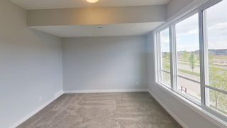 Photo 13: 167 Lucas Boulevard NW in Calgary: Livingston Row/Townhouse for sale : MLS®# A1142913