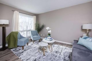 Main Photo: 208 Deerpoint Lane SE in Calgary: Deer Ridge Row/Townhouse for sale : MLS®# A1153798