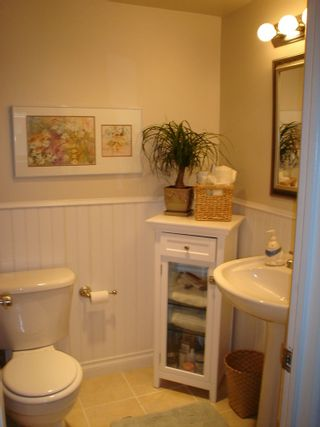 Photo 11: 101 36 E 14th Ave in Rosemount Manor: Home for sale