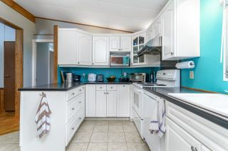 """Photo 16: 58 145 KING EDWARD Street in Coquitlam: Maillardville Manufactured Home for sale in """"MILL CREEK VILLAGE"""" : MLS®# R2612331"""