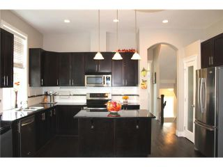 """Photo 7: 1319 SOBALL Street in Coquitlam: Burke Mountain House for sale in """"BURKE MOUNTAIN HEIGHTS"""" : MLS®# V1024016"""