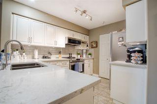 "Photo 10: 202 13860 70 Avenue in Surrey: East Newton Condo for sale in ""Chelsea Gardens"" : MLS®# R2526715"