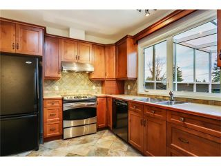 Photo 5: 5623 LODGE Crescent SW in Calgary: Lakeview House for sale : MLS®# C4117298