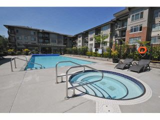 """Photo 4: 107 9199 TOMICKI Avenue in Richmond: West Cambie Condo for sale in """"MERIDIAN GATE"""" : MLS®# R2185974"""