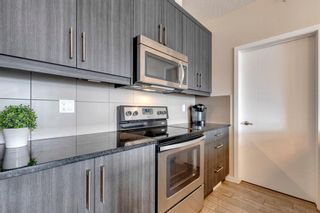 Photo 3: 404 402 Marquis Lane SE in Calgary: Mahogany Apartment for sale : MLS®# A1131322