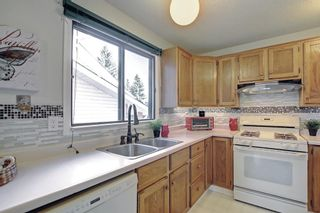Photo 9: 36 Strathearn Crescent SW in Calgary: Strathcona Park Detached for sale : MLS®# A1152503