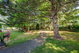 """Photo 30: 12 8737 212 Street in Langley: Walnut Grove Townhouse for sale in """"Chartwell Green"""" : MLS®# R2607047"""