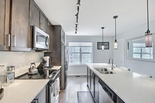 Photo 25: 111 Evanscrest Gardens NW in Calgary: Evanston Row/Townhouse for sale : MLS®# A1135885
