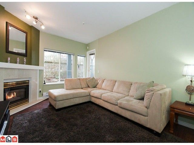 Main Photo: 104 10668 138TH Street in Surrey: Whalley Condo for sale (North Surrey)  : MLS®# F1028184