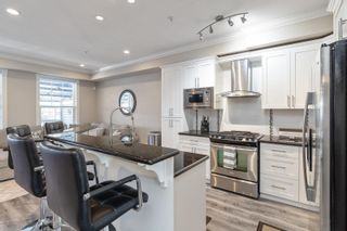 """Photo 3: 21145 80 Avenue in Langley: Willoughby Heights Condo for sale in """"YORKVILLE"""" : MLS®# R2597034"""