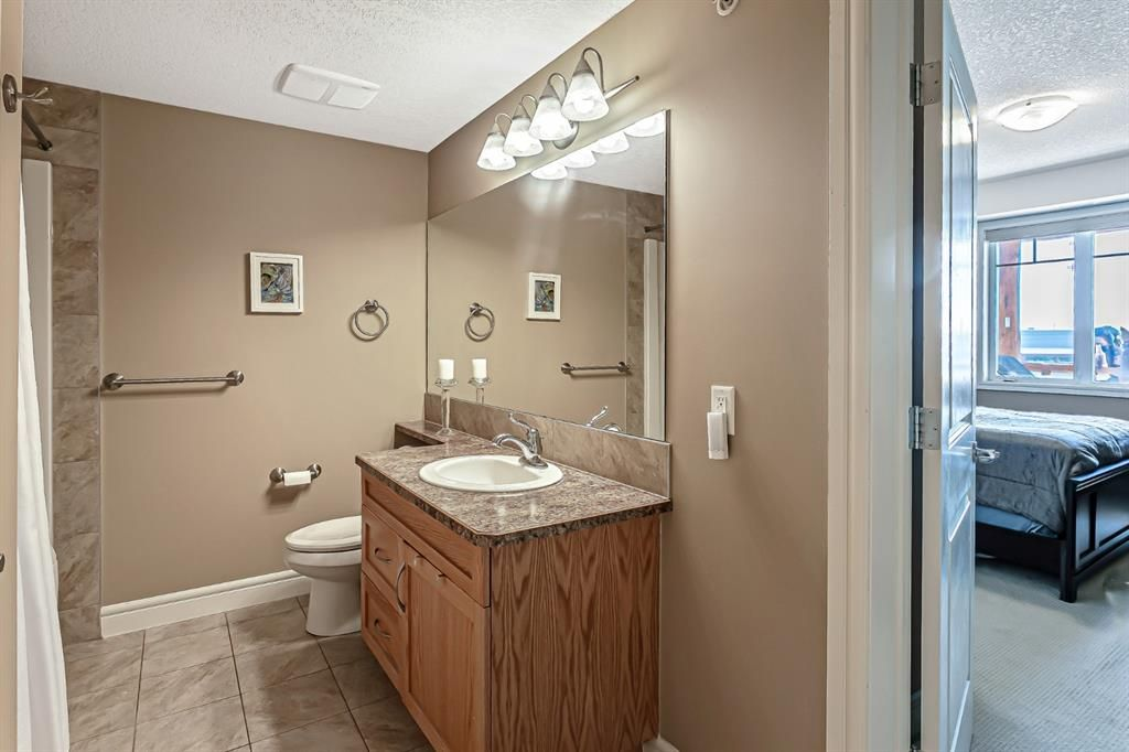 Photo 19: Photos: 1445 2330 FISH CREEK Boulevard SW in Calgary: Evergreen Apartment for sale : MLS®# A1082704