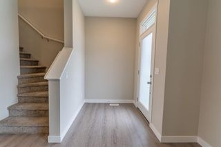 Photo 1: 48 Carringvue Link NW in Calgary: Carrington Semi Detached for sale : MLS®# A1111078