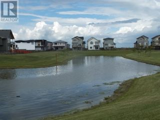 Photo 34: 504 Greywolf Cove N in Lethbridge: House for sale : MLS®# A1153214