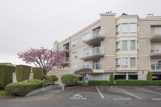 "Photo 1: 306 9295 122 Street in Surrey: Queen Mary Park Surrey Condo for sale in ""Kensington Gardens"" : MLS®# R2574606"