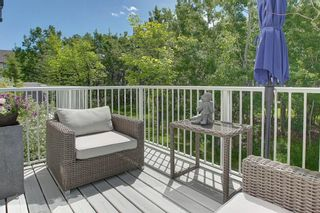 Photo 4: 1707 WENTWORTH Villa SW in Calgary: West Springs Row/Townhouse for sale : MLS®# C4253593