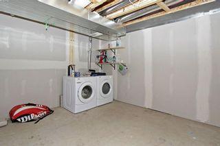 Photo 25: 105 AUBURN BAY Square SE in Calgary: Auburn Bay House for sale : MLS®# C4141384