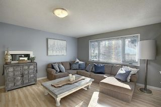 Photo 5: 412 33 Avenue NE in Calgary: Winston Heights/Mountview Semi Detached for sale : MLS®# A1068062