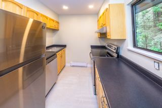 Photo 4: 902 BRITTON Drive in Port Moody: North Shore Pt Moody Townhouse for sale : MLS®# R2443680