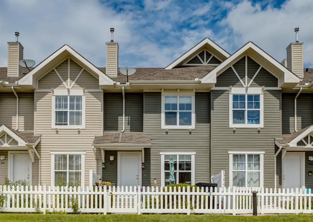 Main Photo: 311 Toscana Gardens NW in Calgary: Tuscany Row/Townhouse for sale : MLS®# A1118245