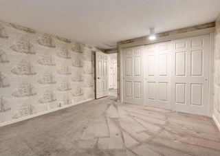 Photo 34: 24 WOOD Crescent SW in Calgary: Woodlands Row/Townhouse for sale : MLS®# A1154480