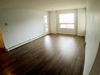 Photo 8: 1304 60 Panatella Street NW in Calgary: Panorama Hills Apartment for sale : MLS®# A1131653