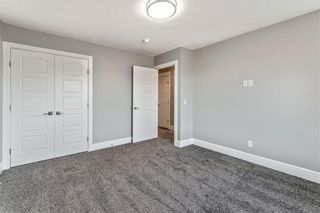 Photo 24: 211 Kinniburgh Place: Chestermere Detached for sale : MLS®# A1078763