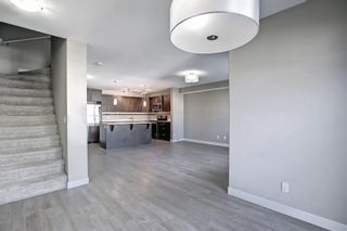 Photo 12: 555 Redstone View NE in Calgary: Redstone Row/Townhouse for sale : MLS®# A1149779