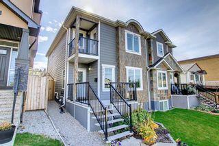 Main Photo: 121 25 Avenue NE in Calgary: Tuxedo Park Semi Detached for sale : MLS®# A1149175
