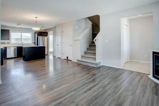 Photo 3: 64 Sunvalley Road: Cochrane Row/Townhouse for sale : MLS®# A1108247