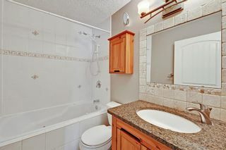 Photo 19: 818 68 Avenue SW in Calgary: Kingsland Detached for sale : MLS®# A1068540