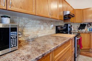 Photo 12: 9 209 Woodside Drive NW: Airdrie Row/Townhouse for sale : MLS®# A1106709