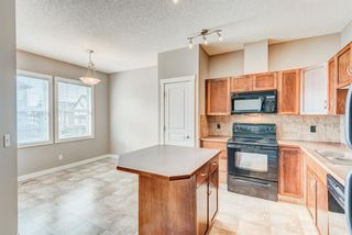 Photo 9: 100 28 Heritage Drive: Cochrane Row/Townhouse for sale : MLS®# A1076913