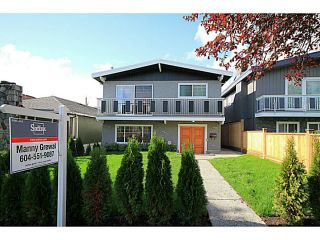 Photo 1: 7357 CULLODEN Street in Vancouver: South Vancouver House for sale (Vancouver East)  : MLS®# V1096878