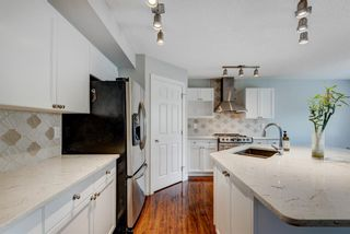 Photo 7: 572 Cougar Ridge Drive SW in Calgary: Cougar Ridge Detached for sale : MLS®# A1143842
